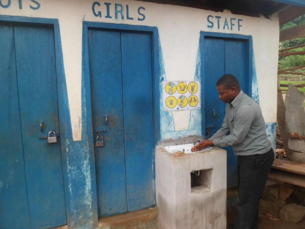 Hand washing after toilet by head teacher