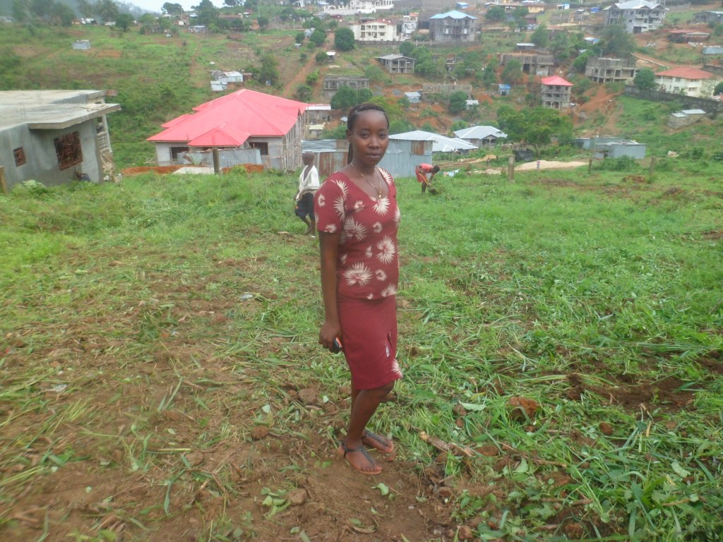 Head mistress standing on school land before work commence