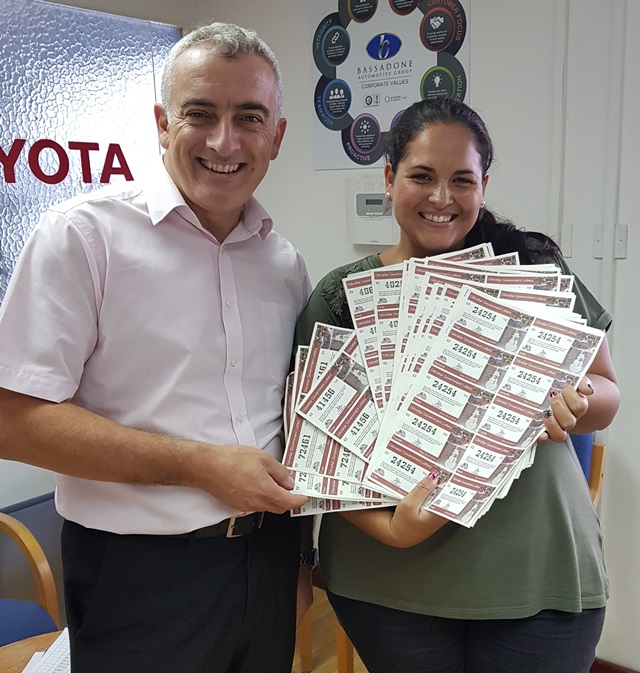 Jimmy Bruzon & Sharaine Dalli who won 1st Prize 75 full lottery tickets (£1,500)