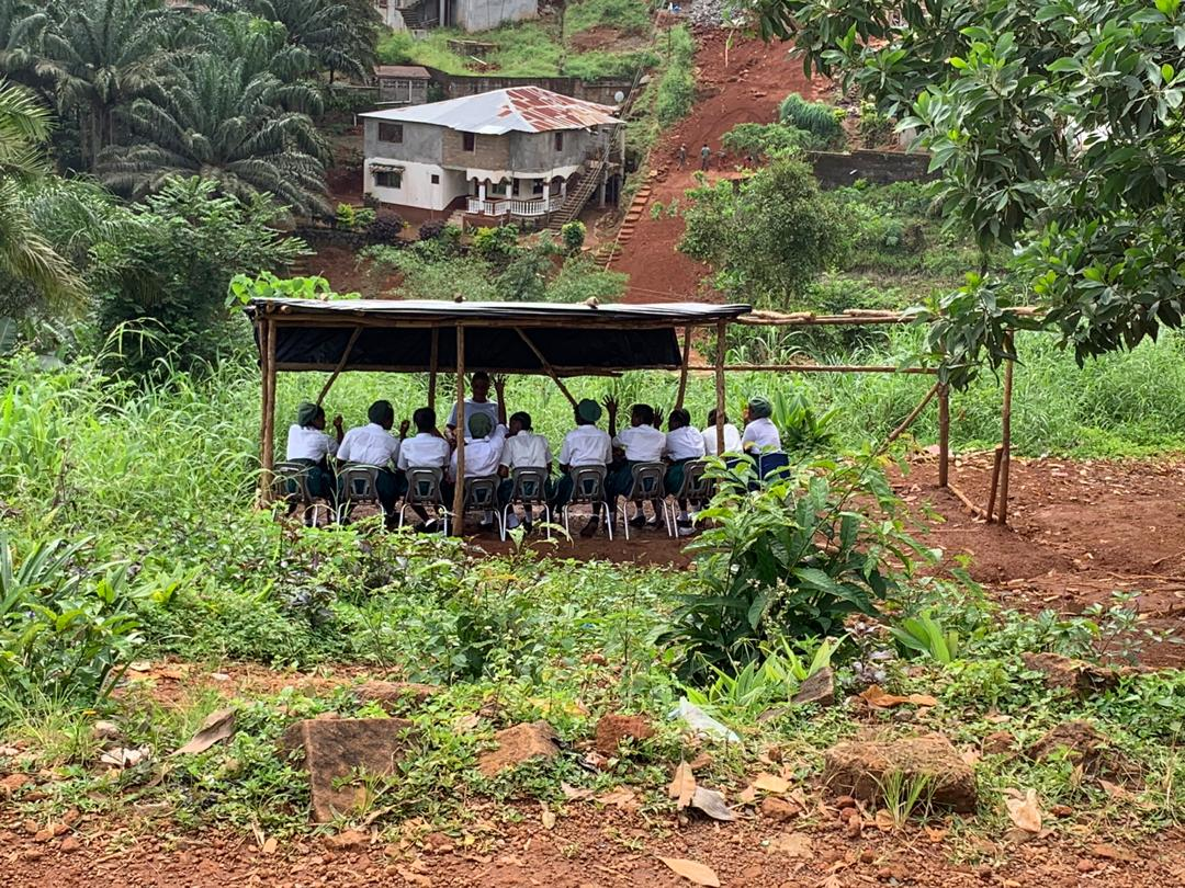 October 2019 - Regent Village has an urgent need for a larger Junior Secondary School and a new  Senior Secondary School.  This photo shows children being taught outdoors because of lack of space at the Junior Secondary School.